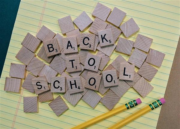 Back to School on wooden tiles