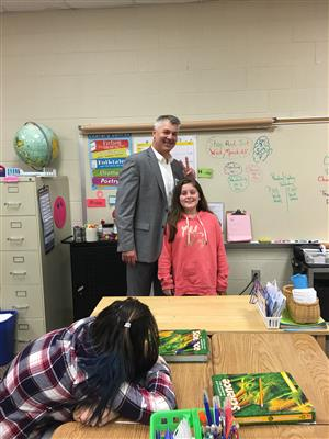 Addie and her dad on Career Day.