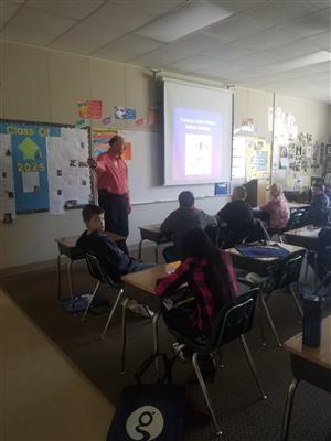 Mr.Council talks to the 5th graders on Career Day.