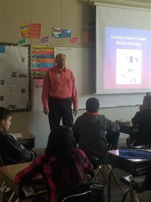 Mr. Council answers questions from the 5th graders on Career Day.