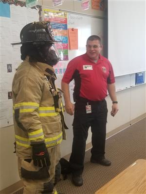 Mr. Hines and the firefighter.
