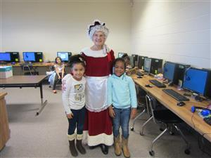 Mrs. Claus in the computer lab with some Kindergarten students.
