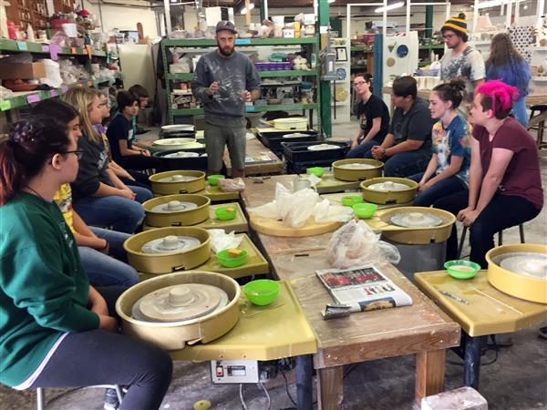Students making pottery