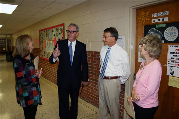 School Board members visit with HHS Principal David Colwell and teacher John Spicer