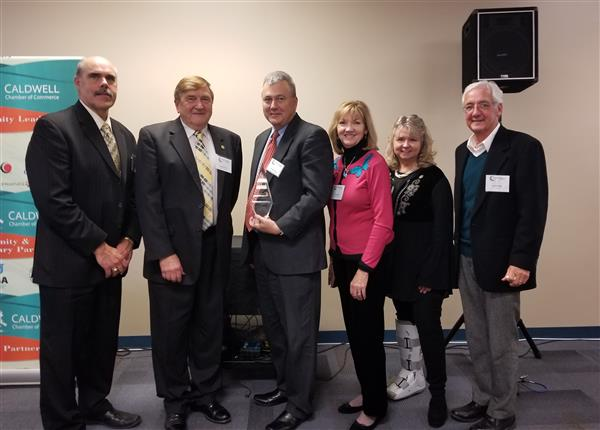 School Board Members stand with Dr. Stone after receiving the Visionary Award
