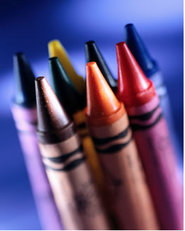 Mulit colored crayons in a group.